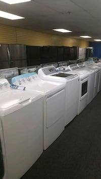 GE new scratch and dent top load set washer and dr Randallstown