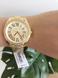 brand new mk women's gold watch. Vancouver, V5R 0A1