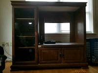 brown wooden TV hutch with flat screen television Middletown
