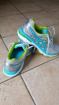 pair of gray-green-and-blue ASICS running shoes