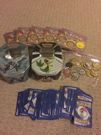 pokemon cards, coins and tins