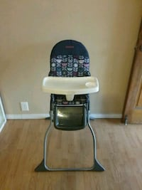 Like new Costco blue folding high chair, 25 firm Colton, 92324