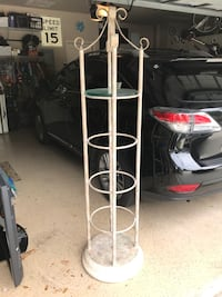 Decorative shelving. Need gone. Beautiful round iron shelving unit with glass shelves. Excellent condition from a smoke free home. First $75 takes it. Will deliver at reasonable distance