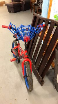 red and blue bicycle with training wheels New York, 10025