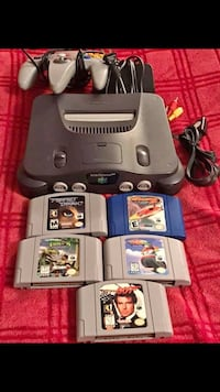 Black nintendo 64 console with controllers and game cartridges. All work and tested Georgetown, 40324