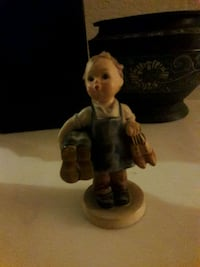 boy holding two pairs of shoes Hummel Goebel figurine