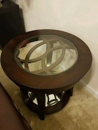 2 brown wooden framed glass-top end tables Frederick, 21703