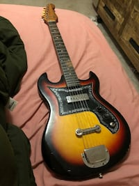Brown and black electric guitar 46 km