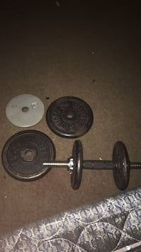 two black dumbbells and barbell District Heights, 20747
