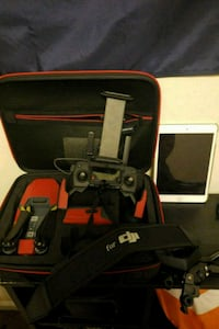 black and red quadcopter drone