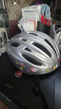 grey cycling helmet with box