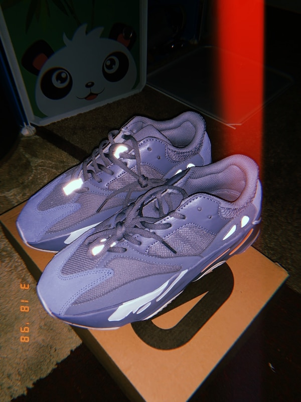 Pair of purple nike running shoes 700 size 7