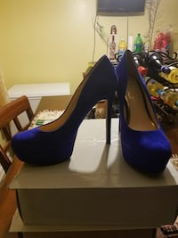 pair of blue suede stiletto platform shoes with