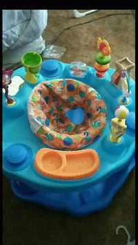 baby's blue and orange activity saucer Beaumont, 92223