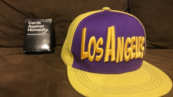 yellow and purple Los Angeles cap