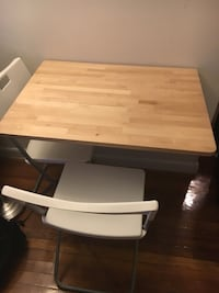 Fold up wooden table  New York, 10016