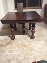 """Antique solid wood table with 8 leafs. 42"""" X 42"""" X 30""""H. Leafs are 10"""" X 42"""" L   Nice for huge family gatherings! Antique dealers encouraged!  Conifer, 80433"""
