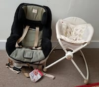 baby's white rock n play sleeper with car seat