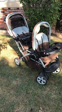 Baby's brown and white double stroller/Sit n stand