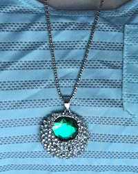 Round silver-colored blue gemstone encrusted pendant chain link necklace
