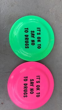 two green and pink plastic plates