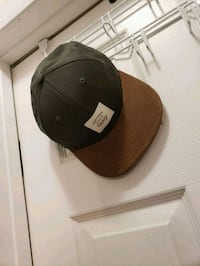 black and brown fitted cap Calgary, T1Y 3W4