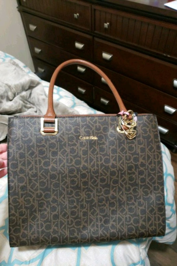 88b1ddd63359 Used black and brown Michael Kors monogram tote bag for sale in Centralia