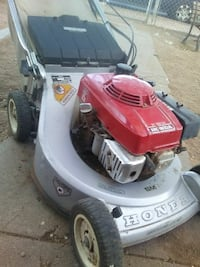 gray and red Honda push mower Lubbock, 79412