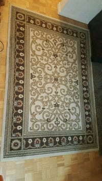 brown and white floral area rug 533 km