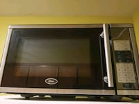 black and gray Oster microwave oven Queens, 11385