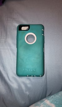 teal and white OtterBox iPhone case 486 mi