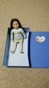 blue and white dressed doll 446 km