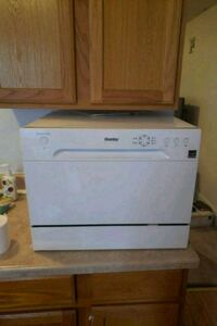white and black front load dish washer