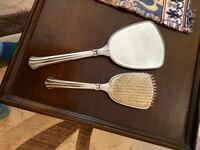 Silver mirror and brush set.