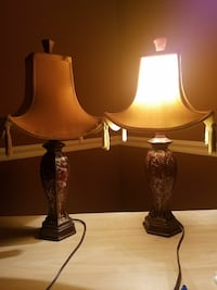 two brown foliage table lamps with square tasseled
