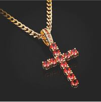 gold-colored necklace with red gemstone pendant null