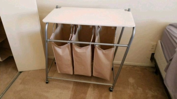 Laundry hamper with ironing board (on wheels)