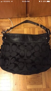 black Coach monogrammed hobo bag