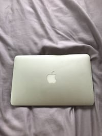 silver MacBook with MagSafe power adapter LANHAM
