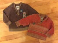two orange and brown pullover sweaters