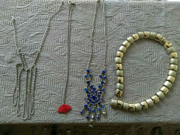 two silver-colored beaded necklaces