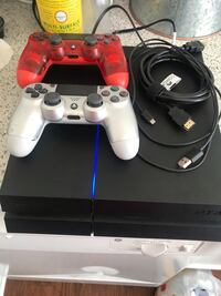 Sony PlayStation 4 used 2 controllers all cords for the system $200. Silver controller one of the top buttons on the right is missing R1 is missing.  Centreville, 20120