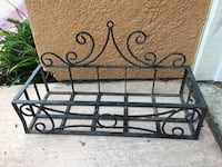 "Hanging metal plant holder... 21.5"" x 8.5"".  attaches to the wall, or just sits. San Marcos, 92069"