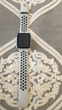 Black and white aluminum case apple watch with white sports band