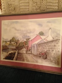 Brown wooden framed painting of house