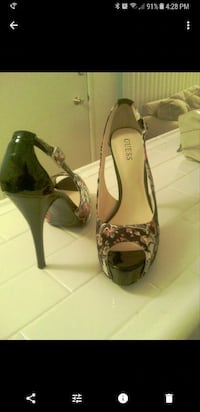 pair of Guess black peep-toe stilettos