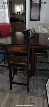 Pub style height table and 4 chairs electric fire place