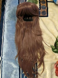 Mauve/brown coloured synthetic wig