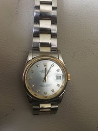 round gold-colored framed Rolex analog watch with silver-colored link bracelet North Vancouver, V7R 1L6