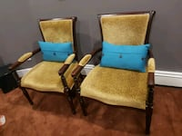 two brown wooden framed green padded armchairs Surrey, V3S 2W9